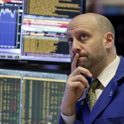 Meric Greenbaum works on the floor of the New York Stock Exchange.  The Associated Press