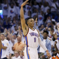 Oklahoma City guard Russell Westbrook  celebrates a three-pointer during the Thunder's win over Golden State in Game 4 on Tuesday.   The Associated Press