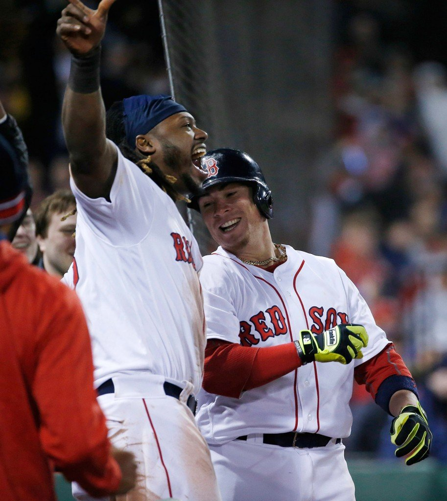 Christian Vazquez, right, celebrates his two-run home run with teammate Hanley Ramirez during the seventh inning. The homer put Boston ahead of the Yankees, 8-6.