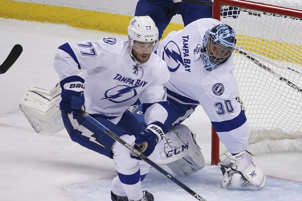 Tampa Bay Lightning goalie Ben Bishop (30) twists his leg as he is injured during the first period of Game 1 against the Pittsburgh Penguins in the Stanley Cup Eastern Conference finals Friday in Pittsburgh. The Associated Press