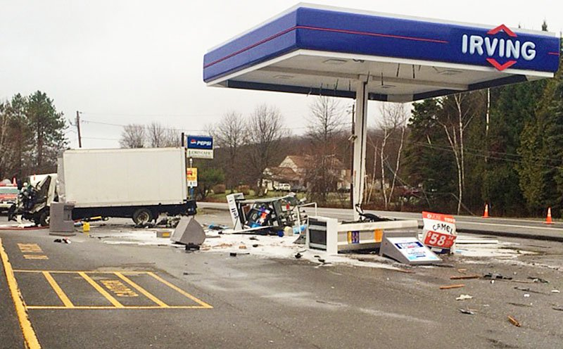 A box truck veered off Route 3 in Liberty Tuesday morning, crashing into utility poles and fuel pumps at a Circle K store/ Irving station. Contributed photo