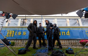 """PORTLAND, ME - MAY 2: Director of photography Aitor Uribarri (cq), left, discusses lighting with the crew outside the Miss Portland Diner during production of """"The Witch Files."""" From left: Uribarri, grip Tadin Brown, gaffer Harper Alexander and key grip Dean Merrill. (Photo by Ben McCanna/Staff Photographer)"""