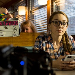 "Actor Holly Taylor of New Jersey, who appears in the FX show ""The Americans,"" waits for the clapperboard to clap at the start of a new take for a scene of ""The Witch Files,"" which was filming Monday at Miss Portland Diner."