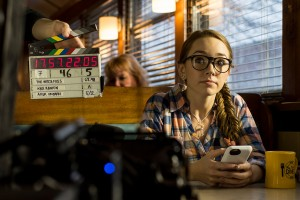 """Actor Holly Taylor of New Jersey, who appears in the FX show """"The Americans,"""" waits for the clapperboard to clap at the start of a new take for a scene of """"The Witch Files,"""" which was filming Monday at Miss Portland Diner."""