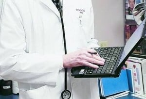 Dr. Joe Davison, M.D. carries a computer tablet that he uses when he visits his patients at West Wichita Family Physicians, March 11, 2010, in Wichita, Kansa. He has easy access to all of his patients' medical history on the tablet. (Jaime Green/Wichita Eagle/MCT)