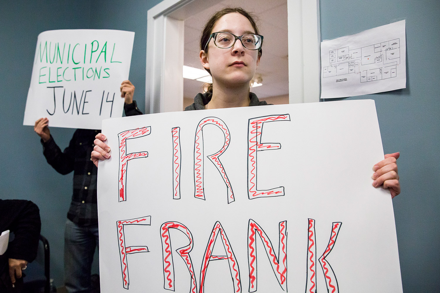 Victoria Hugo-Vidal of Buxton holds a protest sign during a SAD 6 school board meeting Monday. Last week, the board determined that Frank Sherburne had violated the district's nepotism policy by hiring his son for an ed tech position, but the board did not take any action against Sherburne.