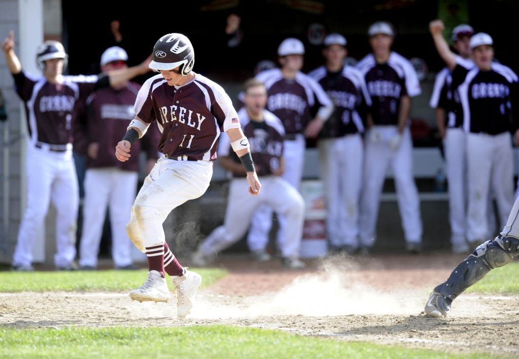 Greely teammates celebrate as Justin Leeman crosses the plate in the sixth inning to give the Rangers a 2-0 lead.  Derek Davis/Staff Photographer