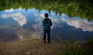Andrew Mullin, 11, of Scarborough, drops a dragonfly lure in Otter Pond from the edge of Turtle Point. Mullin was fly-casting with his grandfather Peter Romano.