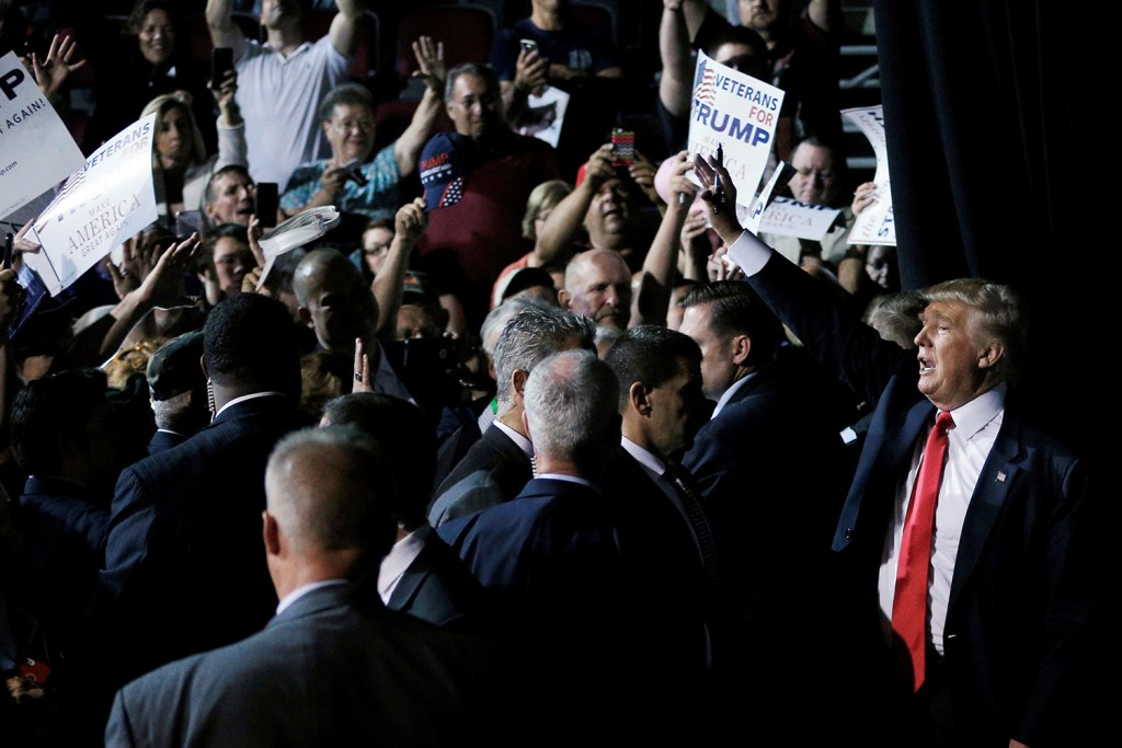 U.S. Republican presidential candidate Donald Trump waves to audience members as he leaves a campaign rally in Bangor on Wednesday.