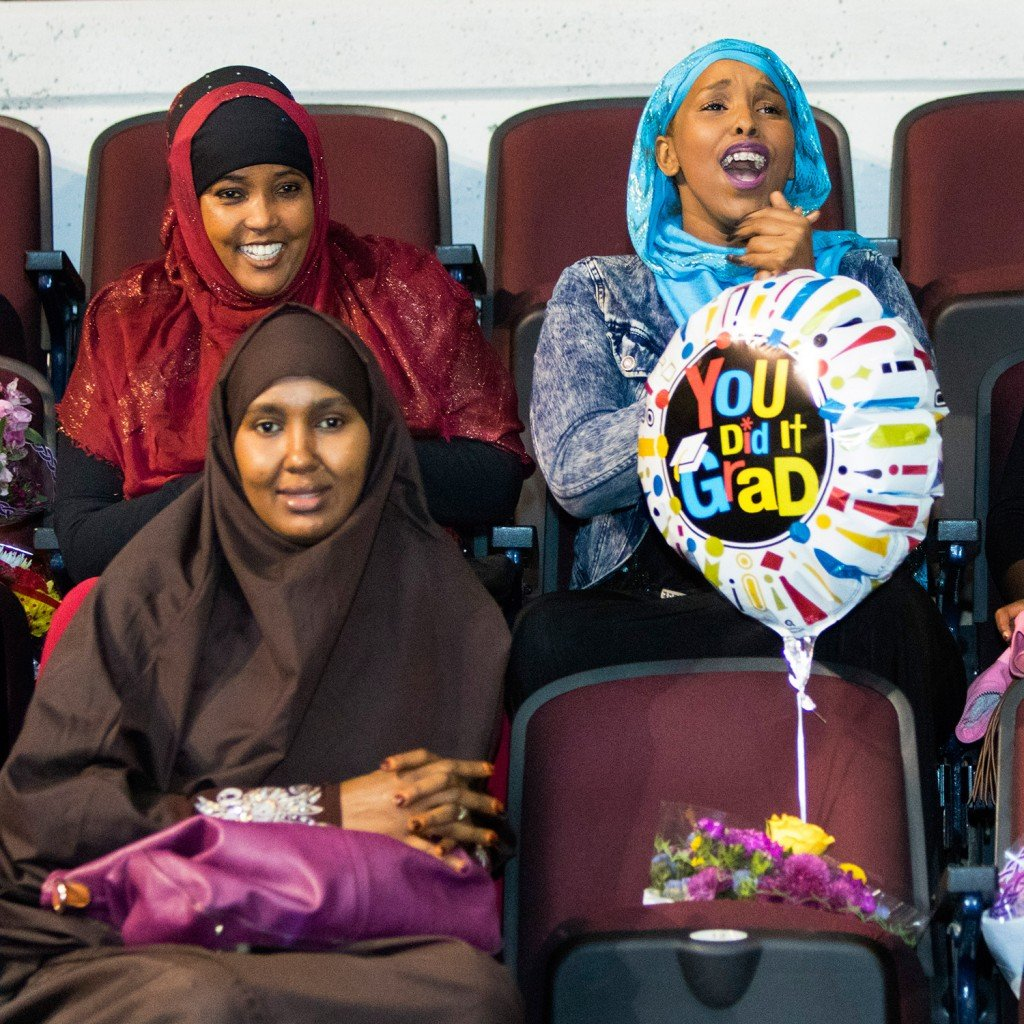 In the audience at the Cross Insurance Arena, clockwise from lower left, Ifrah Mohamud, Sofia Ghelle and Leyla Hashi celebrate Deering High School's graduates, including Ghelle's daughter Sudi Abdi.
