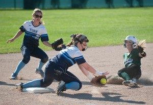 Wendy Donnell of York bobbles the ball as Old Town's Mikayla Richards slides in safely to third base in the fifth inning.