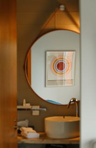 Art decorates every floor, and even this bathroom, at the new 250 Main Grand Hotel in Rockland.