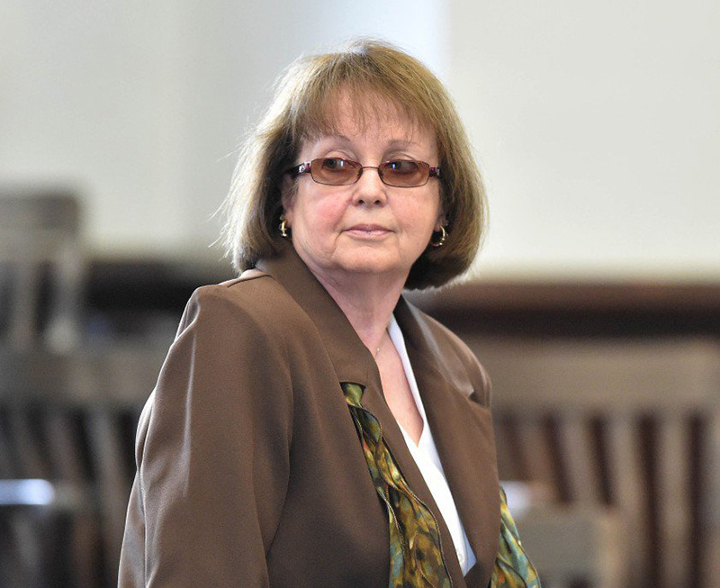Claudia Viles stands as the jury leaves the courtroom to deliberate on the 13 charges against her Wednesday morning, the third day of her trial in Somerset County Superior Court in Skowhegan.