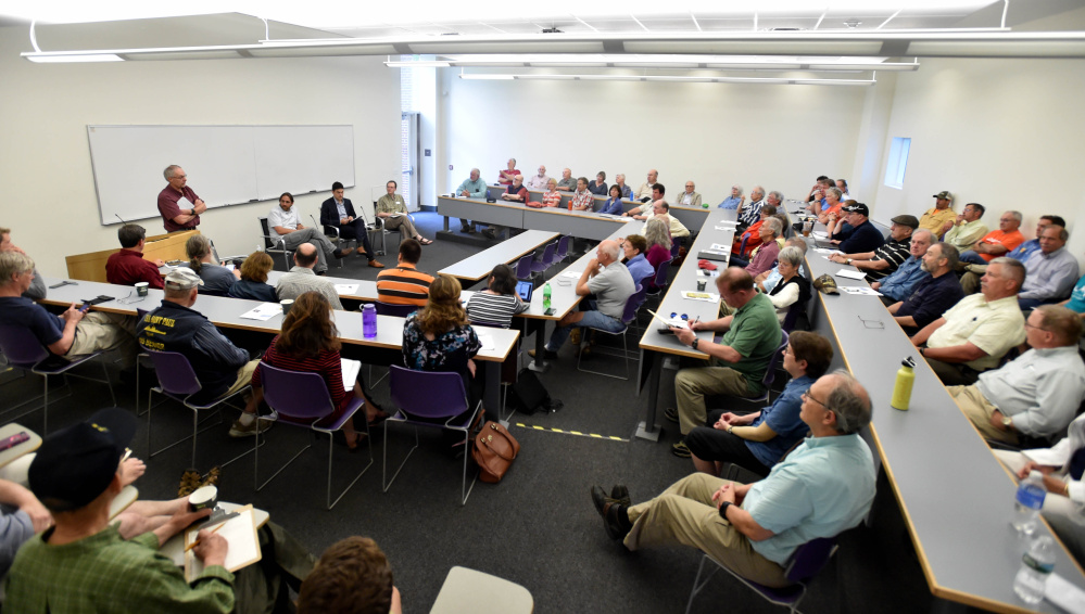 The Pugh Room in the Diamond Building fills to capacity Thursday for The Future of Solar in Maine Forum at Colby College in Waterville.
