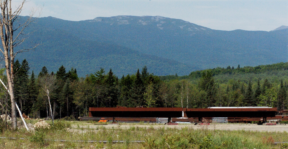 Mount Abram, where a fire has been burning at the summit for nearly a week, is seen Monday from Kingfield. The Maine Forest Service expects the firefighting effort to continue for several days, officials said Tuesday.