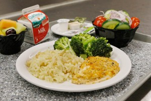 Roast chicken with rice and broccoli, a side salad and fruit cup at Maine Medical Center.