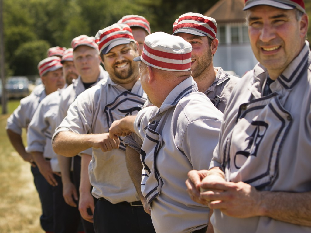 CORNISH, ME - JUNE 25:  Dirigo Base Ball Club member Justin Kirk of Lewiston fist bumps a teammate after a victory in the New England Vintage Base Ball Festival at the Cornish Fairgrounds in Cornish, Maine on Saturday, June 25, 2016. A benefit in helping to restore and preserve the Cornish Fairgrounds, organised by the townÕs historical society and fairground committee, the festival will continue on Sunday with more 1864-rules baseball featuring six vintage base ball clubs from Maine, New England and New Jersey. Some of the rules in place during that era that are different than todayÕs game, include a player is ruled out if the ball is caught by the first hop, a ball that first lands in play that goes foul is considered a fair ball and pitches are made underhand. (Photo by Carl D. Walsh/Staff Photographer)