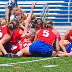 Messalonskee High players pile up at midfield after beating Massabesic 7-6 to win the state Class A girls' lacrosse championship Saturday at Portland's Fitzpatrick Stadium.