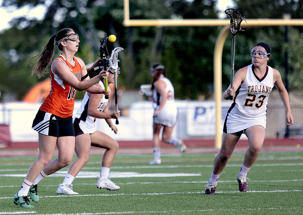 Taylor Turgen of Biddeford, at left, passes the ball upfield past Thornton Academy's Addy Paradis and Rachel Richard during a Class A South girls' lacrosse quarterfinal, on Wednesday. Gabe Souza/Staff Photographer