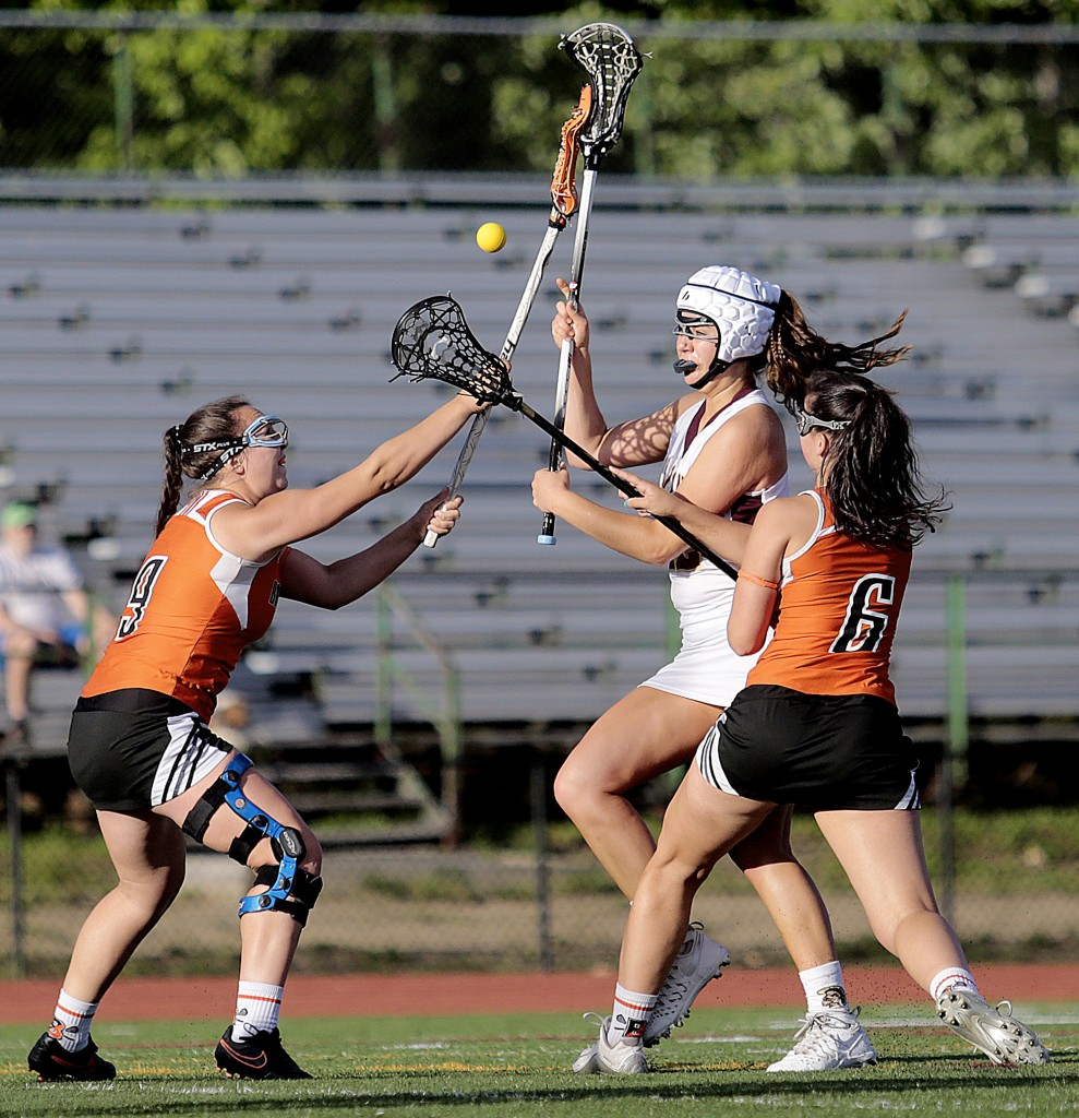 Biddeford defenders Mia Laflamme and Camryn McKeown converge on Thornton Academy's Amanda Cyr during a Class A South girls' lacrosse quarterfinal on Wednesday. Gabe Souza/Staff Photographer