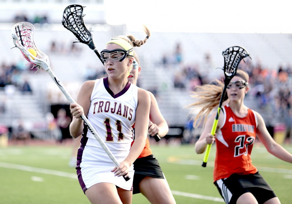 Thornton Academy's Tatum LeClair tries to elude defenders Peyton McKeown and Azure Illiano during a Class A South girls' lacrosse quarterfinal, on Wednesday. Gabe Souza/Staff Photographer