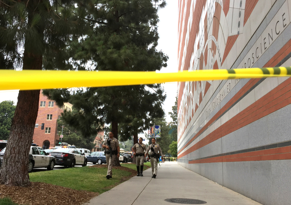 Sheriff's deputies work at the scene of the fatal shooting at the University of California Los Angeles.