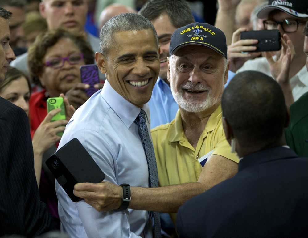 President Barack Obama greets a guest in the audience after speaking at Concord Community High School in Elkhart, Ind., on Wednesday.
