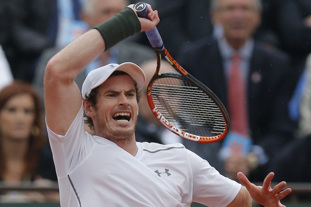 Andy Murray returns the ball to Richard Gasquet of France during their quarterfinal match Wednesday at the French Open. Murray recovered from losing the first set and will take on Stan Wawrinka, the defending champion, in the semifinals.