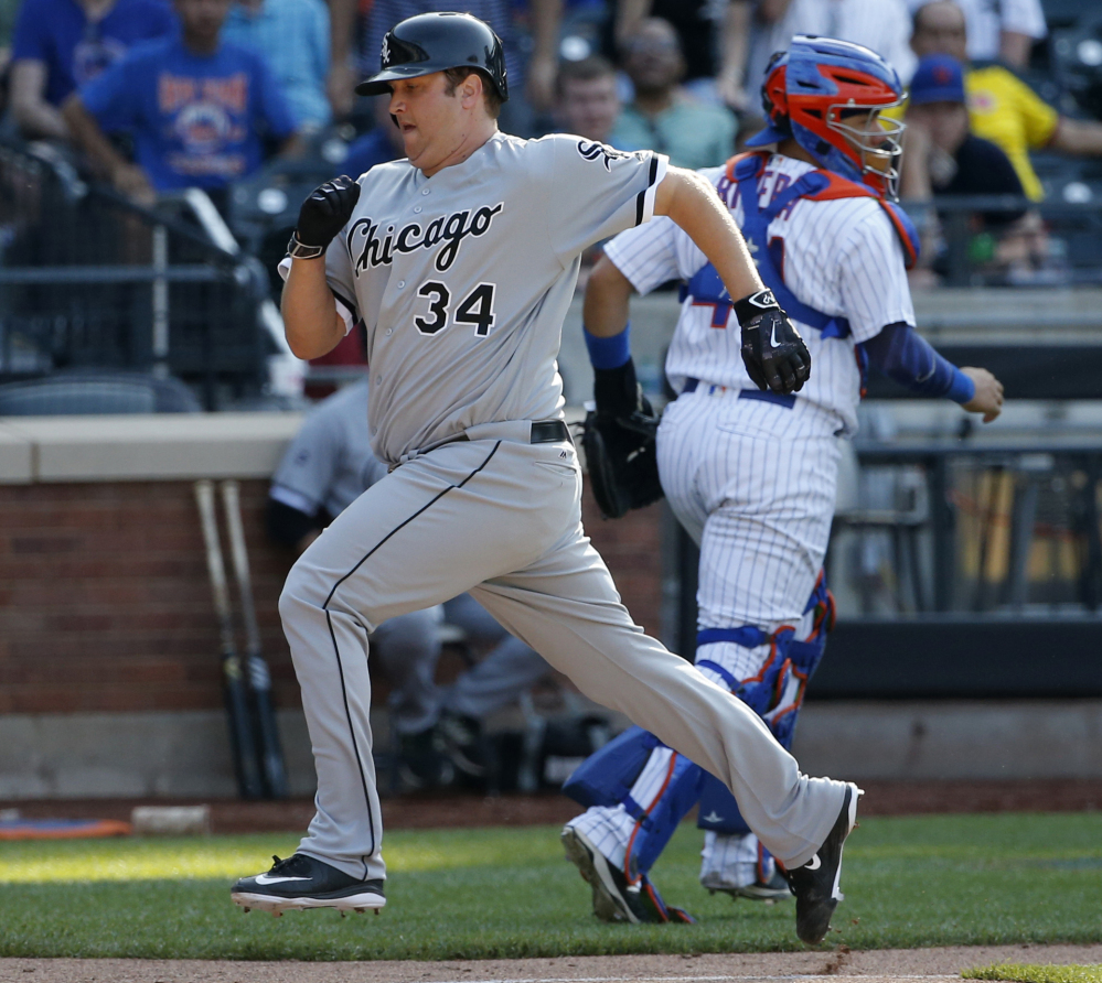 Pitcher Matt Albers of the White Sox scores on Jose Abreu's 13th-inning sacrifice fly to put Chicago ahead in a 2-1 win over the Mets at New York.