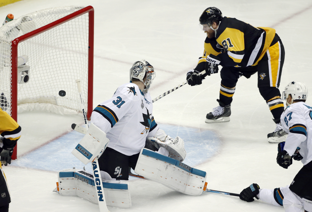 Phil Kessel of the Penguins scores a goal behind San Jose Sharks goalie Martin Jones in the second period in Game 2 of the Stanley Cup Final on Wednesday in Pittsburgh.
