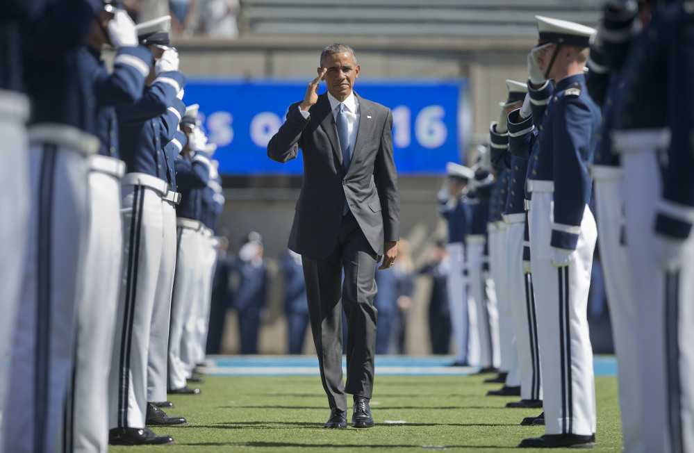 President Obama returns a salute as he arrives to deliver his final commencement address as president to the 2016 class at the U.S. Air Force Academy on Thursday in Colorado Springs, Colo.