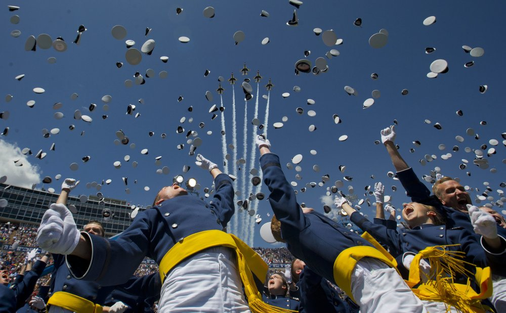 The Air Force Thunderbirds fly overhead as cadets celebrate by tossing their hats after graduation at the Air Force Academy on Thursday in Colorado Springs, Colo. One of the jets crashed after a flyover of the commencement, attended by President Obama.