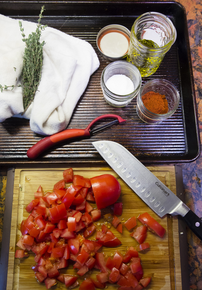 Cooking essentials from home make the trip with the writer to a rental cabin: Sharp knife, cutting board, vegetable peeler, jars of olive oil and seasonings, even fresh herbs. Carl D. Walsh/Staff Photographer