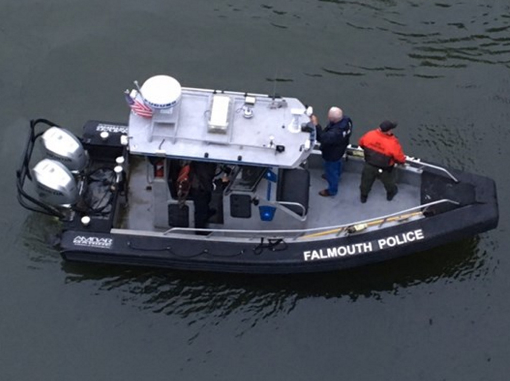 Police search the Presumpscot River in Falmouth on Thursday for a missing teenager. The search was to resume early Friday.