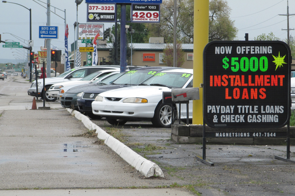 Payday loans are promoted in Boise, Idaho. Each year, roughly 12 million Americans take out a payday loan, according to The Pew Charitable Trust.