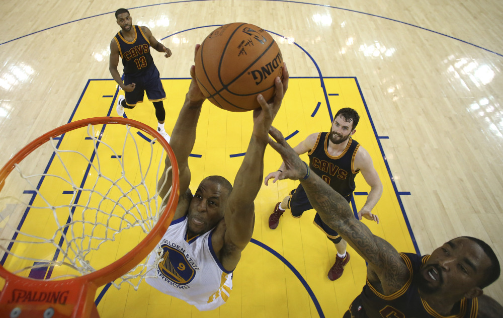 Golden State forward Andre Iguodala dunks against the Cavaliers in the first half. Iguodala finished with 12 points, seven rebounds and six assists.