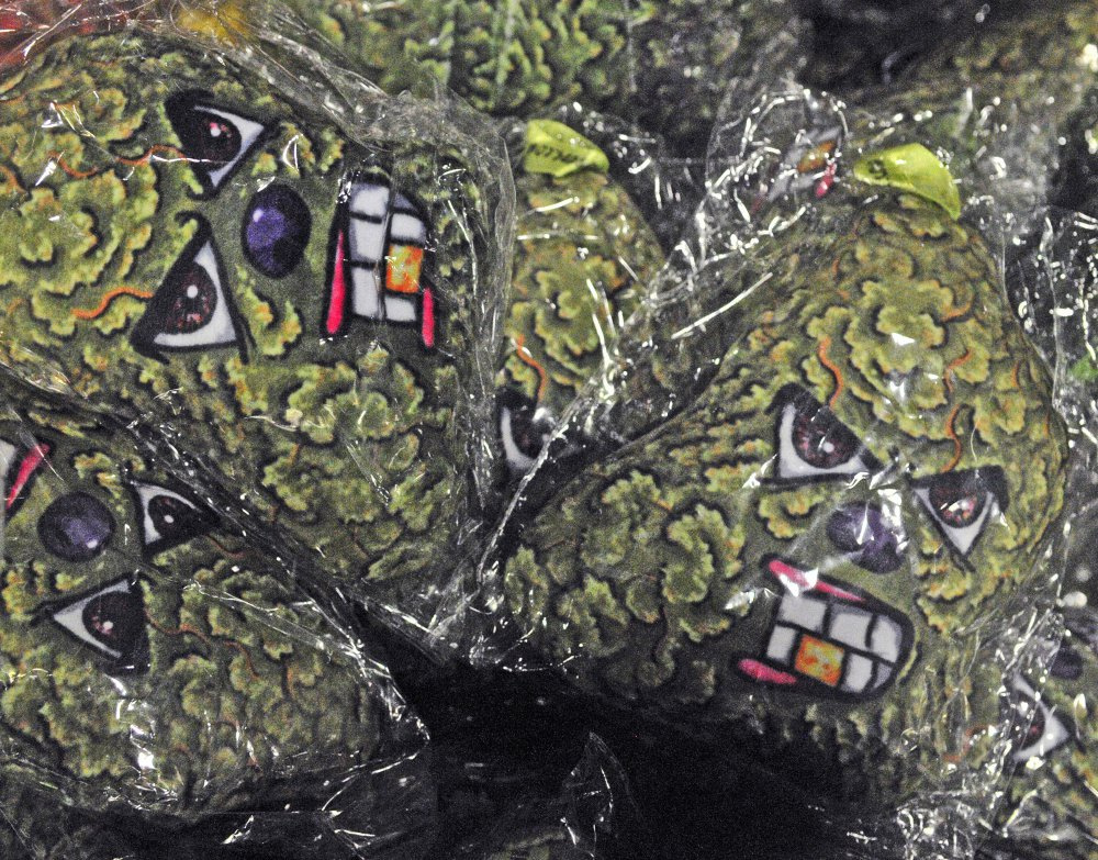 """Toys of Charlie Cheeba and the other characters from the video game are on display at the """"Angrybuds.com"""" booth on Friday as people set up displays for the Medical Marijuana Caregivers of Maine annual show at the Augusta Civic Center, which runs Saturday and Sunday."""