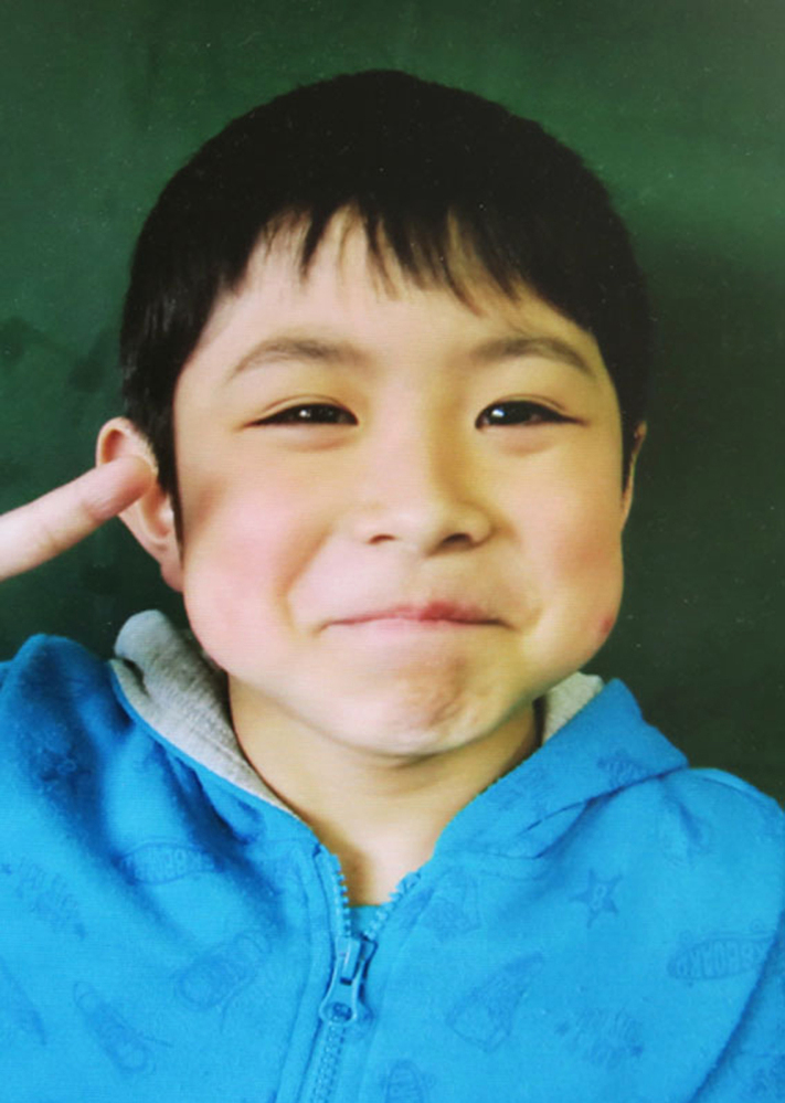 Seven-year-old Yamato Tanooka was found safe nearly a week after he was abandoned in the forest by his parents in Nanae, Hokkaido, northern Japan. This photo was taken by his school before he went missing.