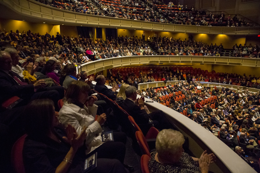 A crowd of close to 1,500 fills Merrill Auditorium for Friday's service for Portland attorney Peter DeTroy, who died late last month.