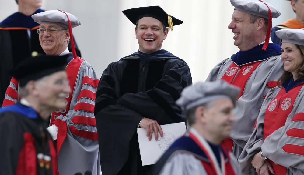 Actor Matt Damon joins the academic procession at the Massachusetts Institute of Technology's commencement in Cambridge, Mass., on Friday.