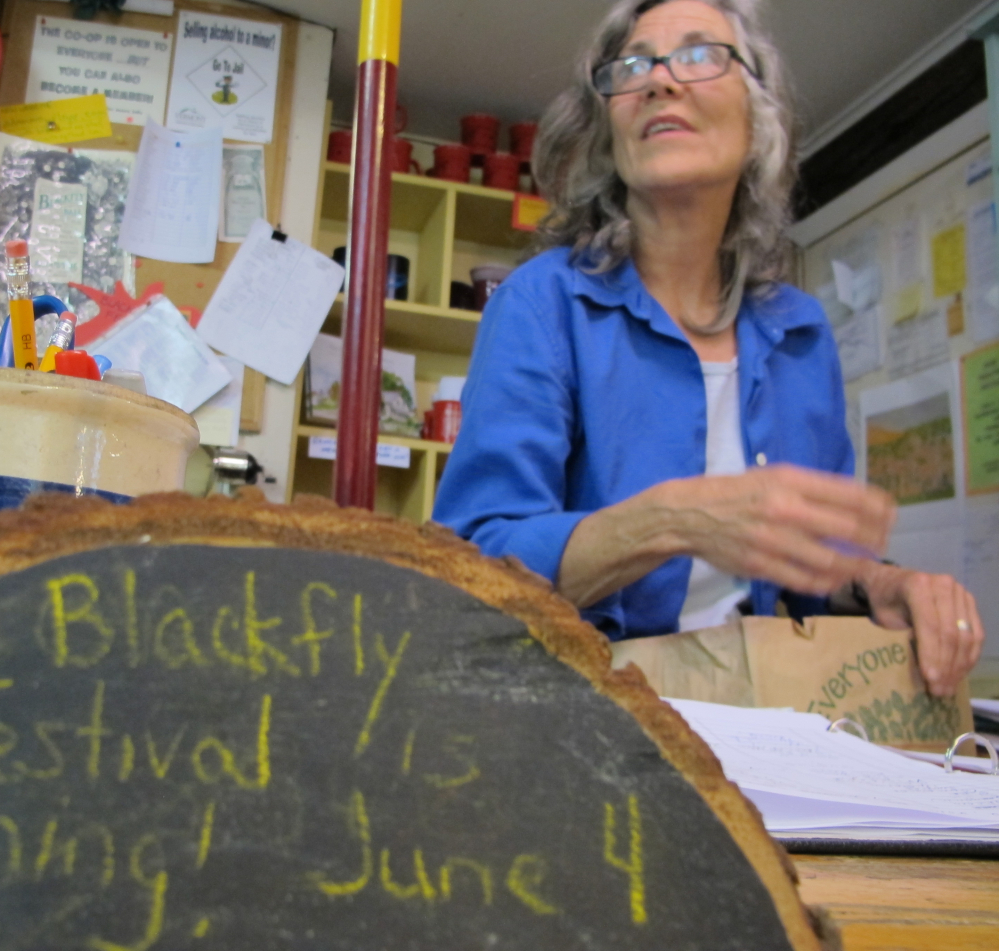 Jennifer Zollner, a clerk at the Adamant Co-op., hopes the blackflies won't overstay their welcome, but looks forward to the 13th annual Adamant Blackfly Festival.