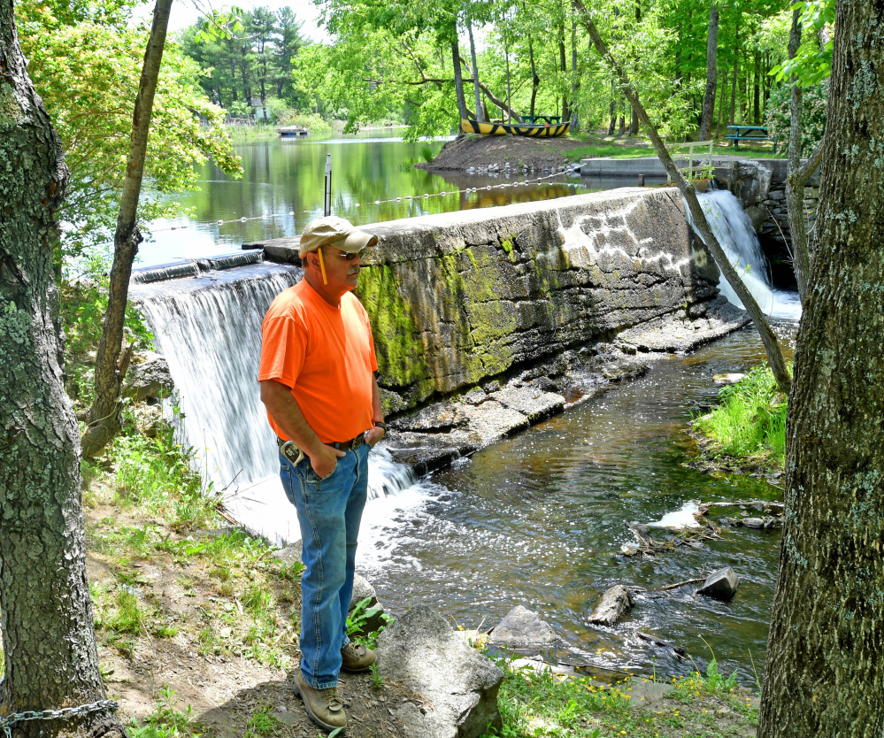 Standing by Mill Pond and Mill Stream Dam in Vassalboro on Wednesday, Dwayne Rioux shares his concern that removal of dams on Outlet Stream will let non-native fish species upstream. Other residents worry about the effect on pond wildlife.