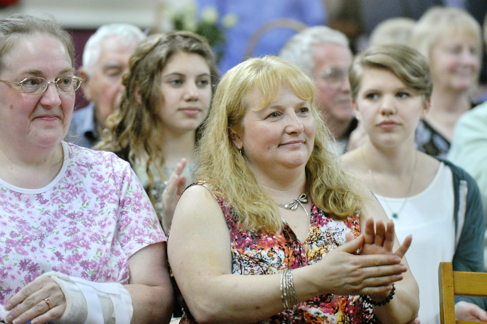 Katherine Jordan of Durham, a niece of Nancy Randall Clark, applauds a story told about her aunt at the celebration honoring Clark's life.