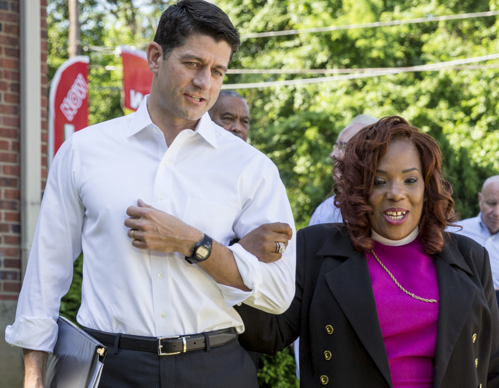 House Speaker Paul Ryan walks with Bishop Shirley Holloway, director of the House of Help City of Hope in Anacostia, one of Washington's poorest areas, on Tuesday. .Associated Press/ J. Scott Applewhite