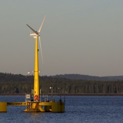 In this photo made Friday, Sept. 20, 2013, the country's first floating wind turbine, the University of Maine's 9,000-pound prototype, generates power off the coast of Castine, Maine. Records show Gov. Paul LePage's administration was working behind the scenes to derail Norwegian company Statoil's proposal for an offshore wind project that's projected to bring hundreds of millions of dollars in investments to the state. (AP Photo/Robert F. Bukaty)