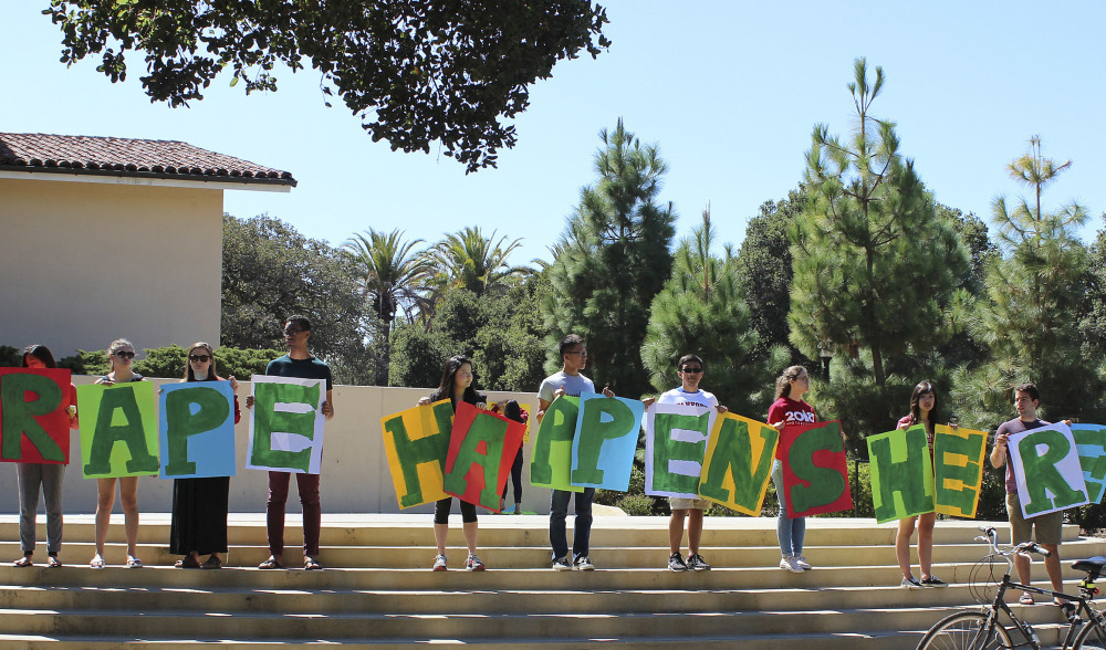 Students hold up a sign about rape during New Student Orientation in September on the Stanford University campus. Stanford considers itself a national leader on preventing and handling sexual assaults, but students have complained that the school isn't doing enough.