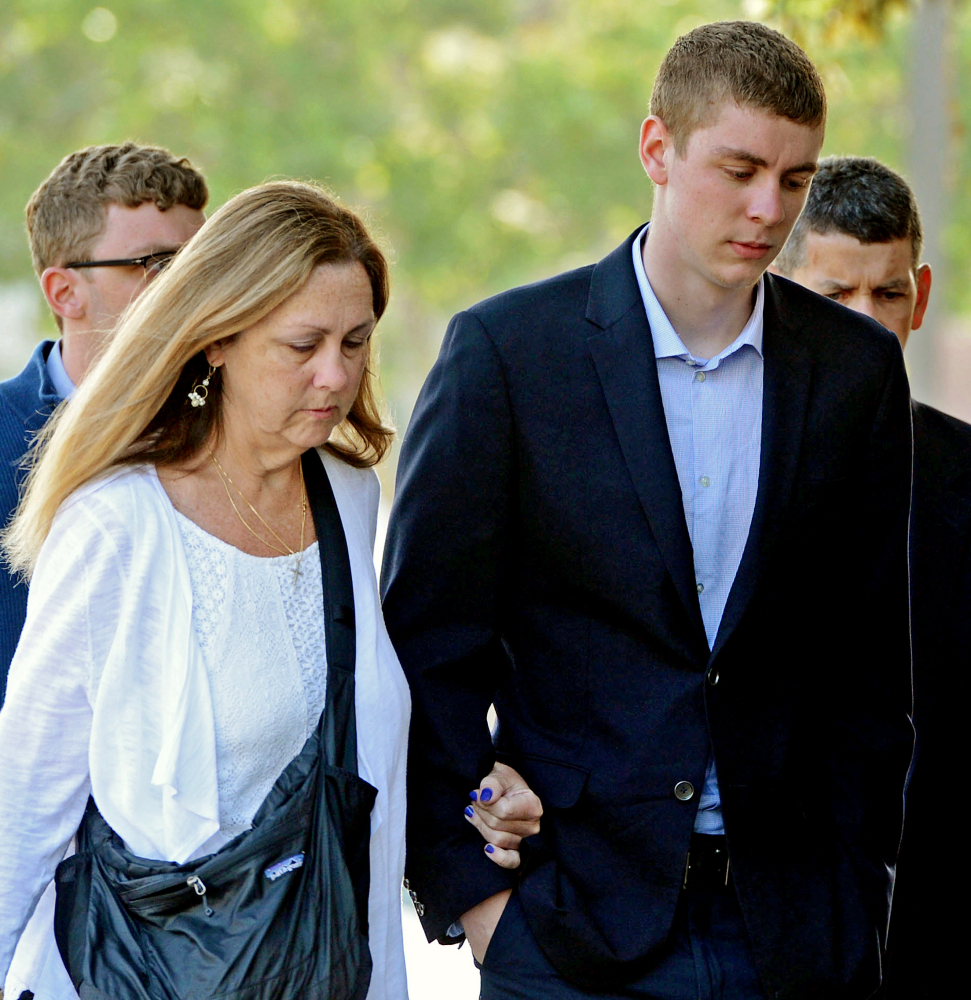 Brock Turner, right, makes his way into the Santa Clara Superior Courthouse in Palo Alto, Calif., on June 2. A letter written by Turner's father was made public by a Stanford law professor who wants the judge in the case removed from office because of Brock Turner's six-month sentence.