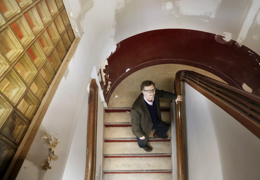 "Don Tuski stands in a stairwell under repair in 2014 at the Maine College of Art in Portland. ""MECA has become a much stronger institution under Don's leadership. His six years as president has made MECA truly competitive in the world of art education,"" said Debbie Reed, board chairman."