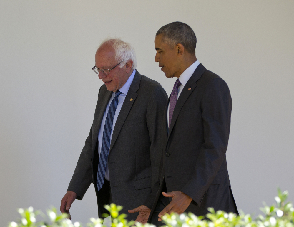President Barack Obama walks with Democratic presidential candidate Sen. Bernie Sanders, I-Vt., along the Colonnade of the White House in Washington on Thursday.