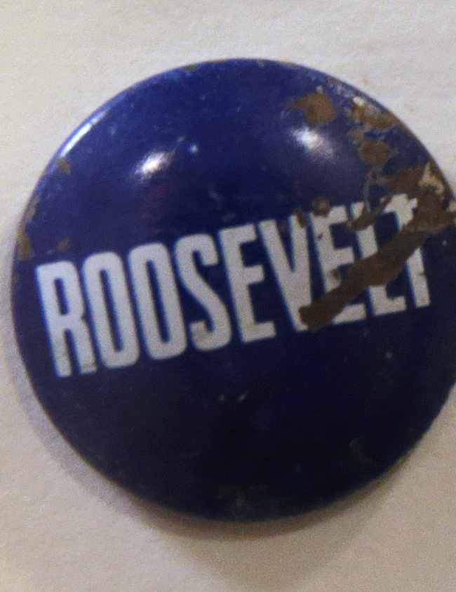 A Roosevelt campaign pin is displayed at Boston Children's Hospital in Boston, Wednesday, June 8, 2016. The items are part of a collection of items ingested by children, a gruesome reminder to dozens of parents who walk past them every day, at the entrance of the hospital's ear, nose and throat department. Children's doctor Anne Hseu says it catches the eye of parents and warns them to be careful of what their child is exposed to. (AP Photo/Charles Krupa)